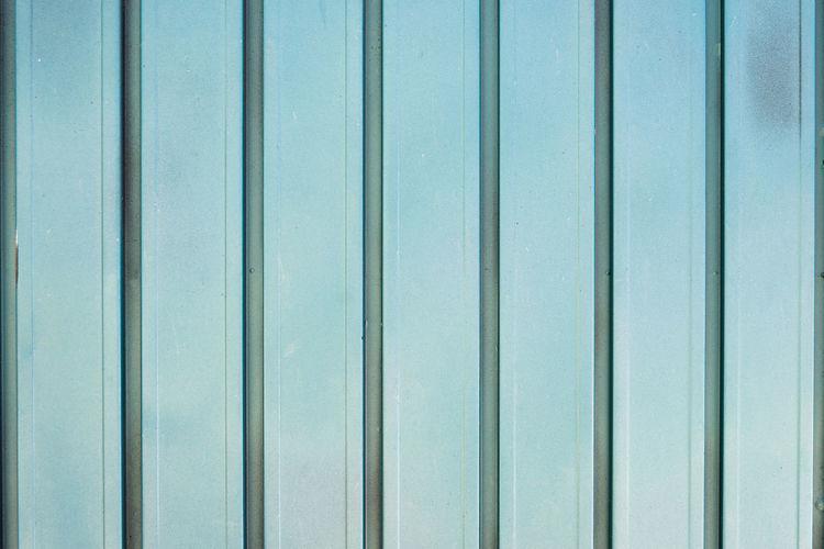 Full frame shot of blue metal wall