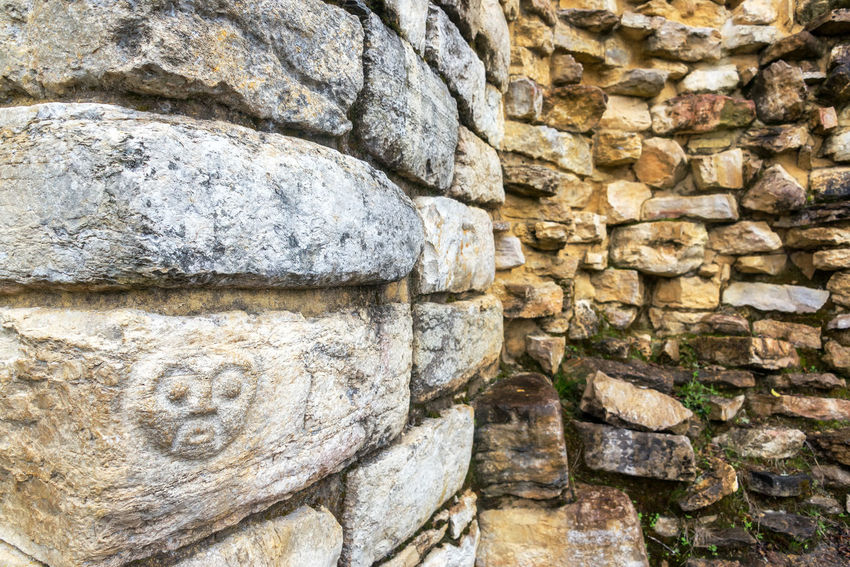 Face carved on stone in the ruins of Kuelap, Peru Amazonas Ancient Antiquities Archaeology Architecture Building Built Chachapoyas Civilization Culture Day Fortification Fortress Historical Inca Kuelap Nature Old Outdoors Peru Preincas Region Ruin Stone Traditional