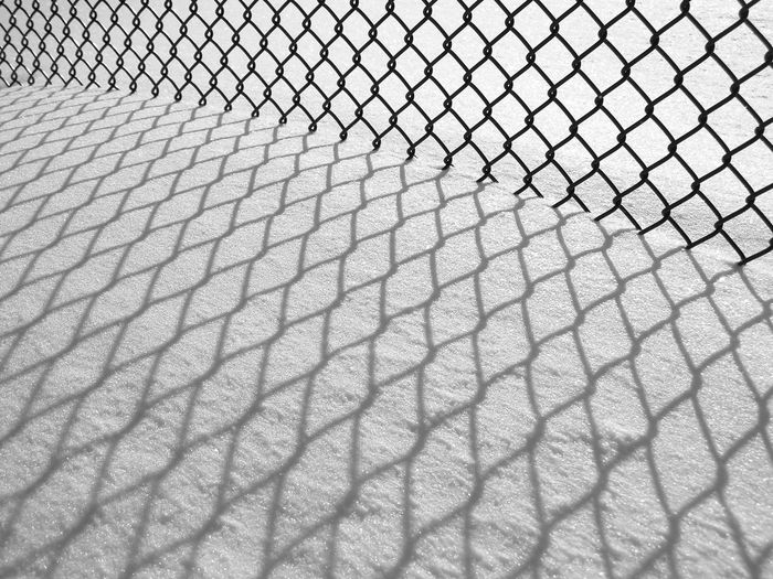 Chainlink fence on snow covered field
