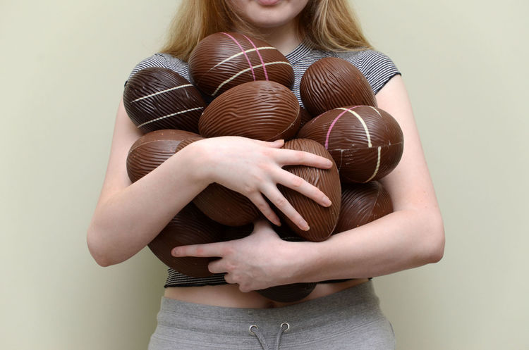 Mine! Bare Arms Chocolate Eggs Easter Eggs Easter Eggs On Display Holding Indoors  One Person Plenty Real People Standing Young Adult Young Woman