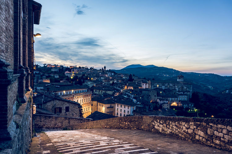 Evening comes to Perugia TOWNSCAPE Outdoors High Angle View Dusk Mountain Street Old No People Cityscape Cloud - Sky Nature Town Residential District Sky Building City Building Exterior Built Structure Architecture My Best Photo