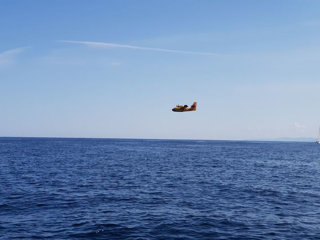 sécurité civile corsica Fire Fire Plane Plane Securite Civile Water Sea Clear Sky Oil Pump Business Finance And Industry Blue Sky Horizon Over Water