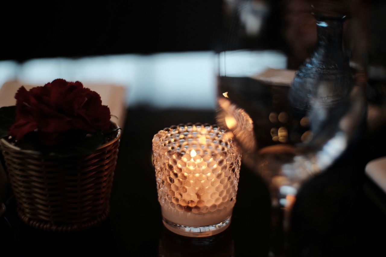 Wine glass lit by candle