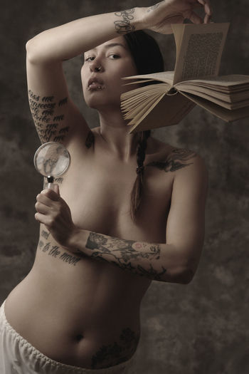 read me Armpit Art Beautiful Woman Book Enlargement Glass Erotic_photo Fine Art Fine Art Photography Foto Art Indoors  One Person Photo Art Portrait Real People Shirtless Standing Surreal Surrealism Surrealism And Fantasy Art Young Adult Young Women