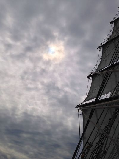 Hansesail 2014 - Brigg: Aphrodite Architecture Beauty In Nature Bright Building Exterior Built Structure Cloud - Sky Day Lens Flare Low Angle View Mast Nature Nautical Vessel No People Outdoors Overcast Sailboat Sailing Vessel Ship Sky Sun Sunlight