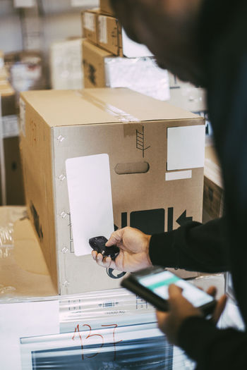 Low angle view of man working in box