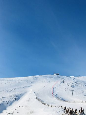 Beauty In Nature Blue Clear Sky Cold Temperature Copy Space Day Landscape Mountain Nature No People Outdoors Scenics Ski Holiday Ski Lift Sky Snow Snowcapped Mountain Sport Sunlight Tranquil Scene Tranquility Vacations Weather Winter Winter Sport