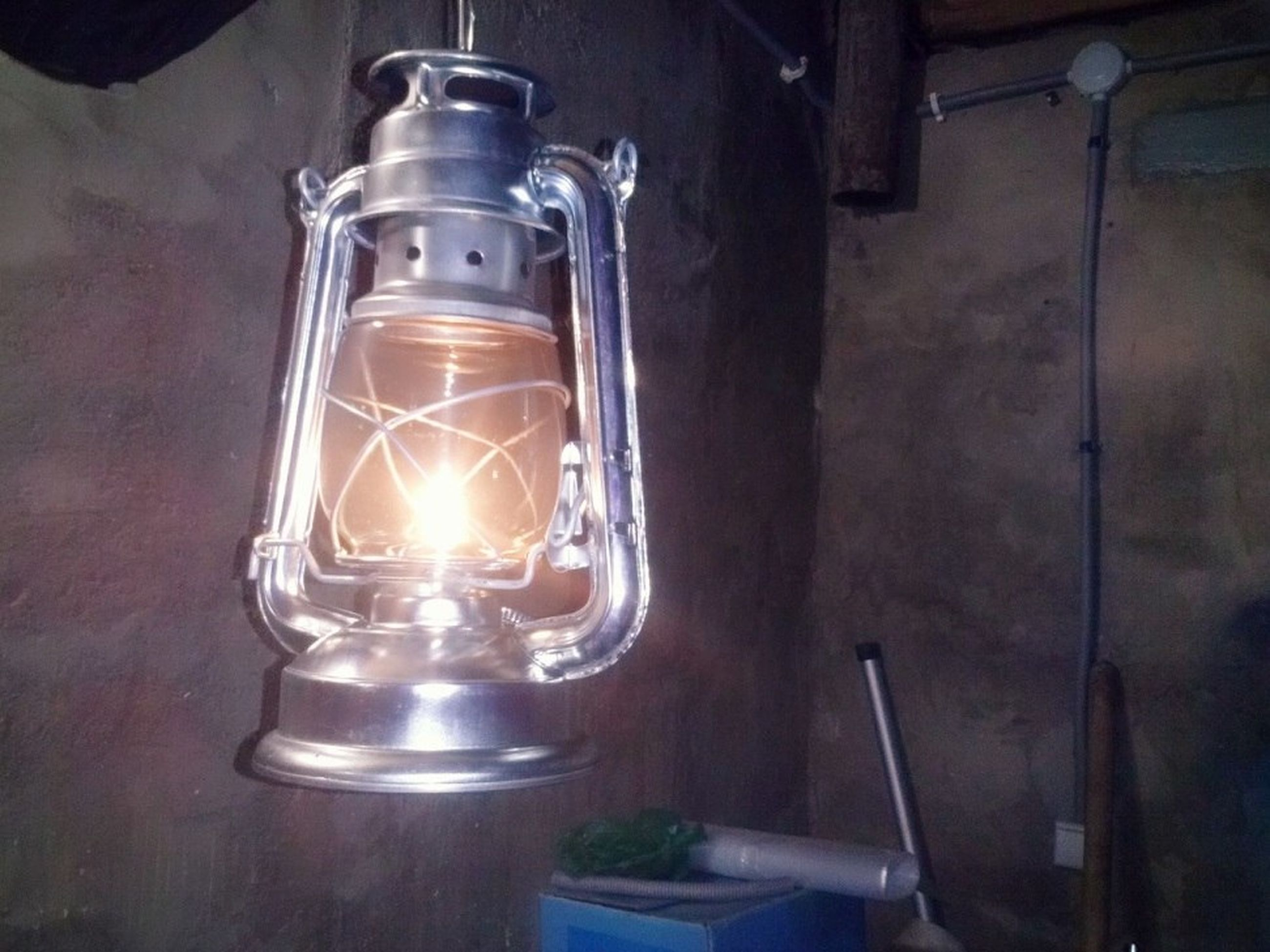 indoors, close-up, electricity, metal, still life, lighting equipment, heat - temperature, burning, flame, illuminated, light bulb, fuel and power generation, old-fashioned, table, technology, glowing, no people, lit, glass - material, home interior