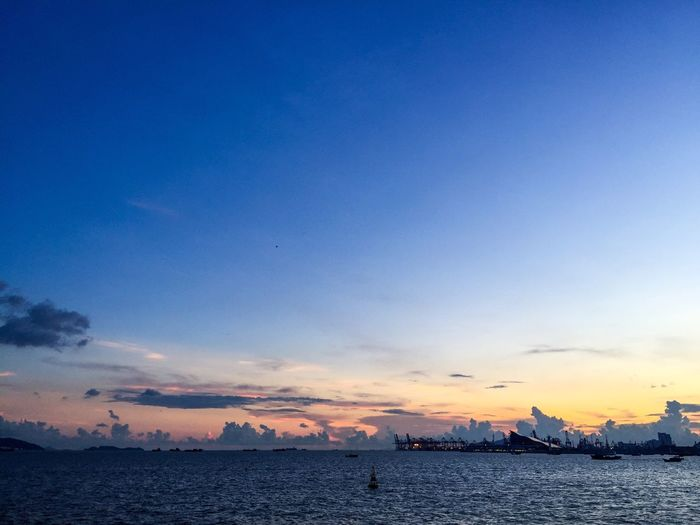 Sunset Sky Sea Scenics Blue Water Beauty In Nature Nature Tranquility Tranquil Scene No People Outdoors Silhouette Nautical Vessel Day Shenzhen China
