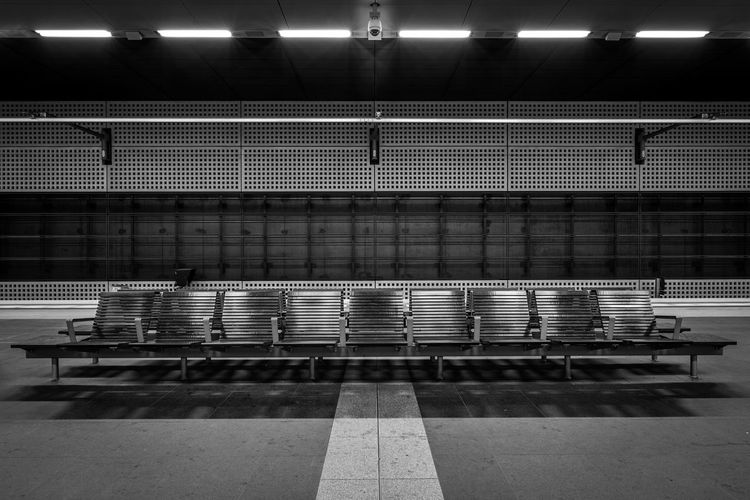 Empty Chairs At Illuminated Subway Platform