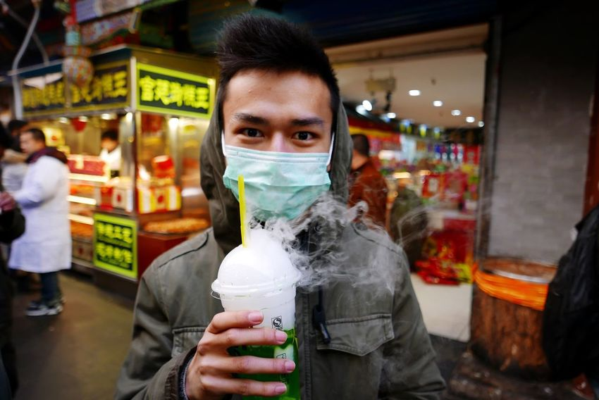 Wut's this?!? Portrait Streetphotography Drinking Drink Steam Smoke China Chinese Chinese Boy Asian  ASIA Asian Culture Man Men Masked Mask Straw It's Cold Outside Showcase: January Street Food Worldwide The Portraitist - 2017 EyeEm Awards