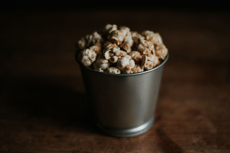 Toffee popcorn Popcorn Food And Drink Food Indoors  Wood - Material No People Snack Freshness Ready-to-eat Close-up Single Object Indulgence Wellbeing Wood Grain Brown
