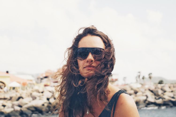 Beautiful Sunglasses Sunglasses Portrait Photography Portrait Of A Woman Portraits Portrait Swinginginaplumtree EyeEm Selects Close-up Sunglasses One Person Real People Long Hair Focus On Foreground Young Adult Outdoors Young Women Sky Headshot Portrait Beautiful Woman Sea Adult