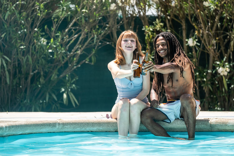 Couple sitting in swimming pool
