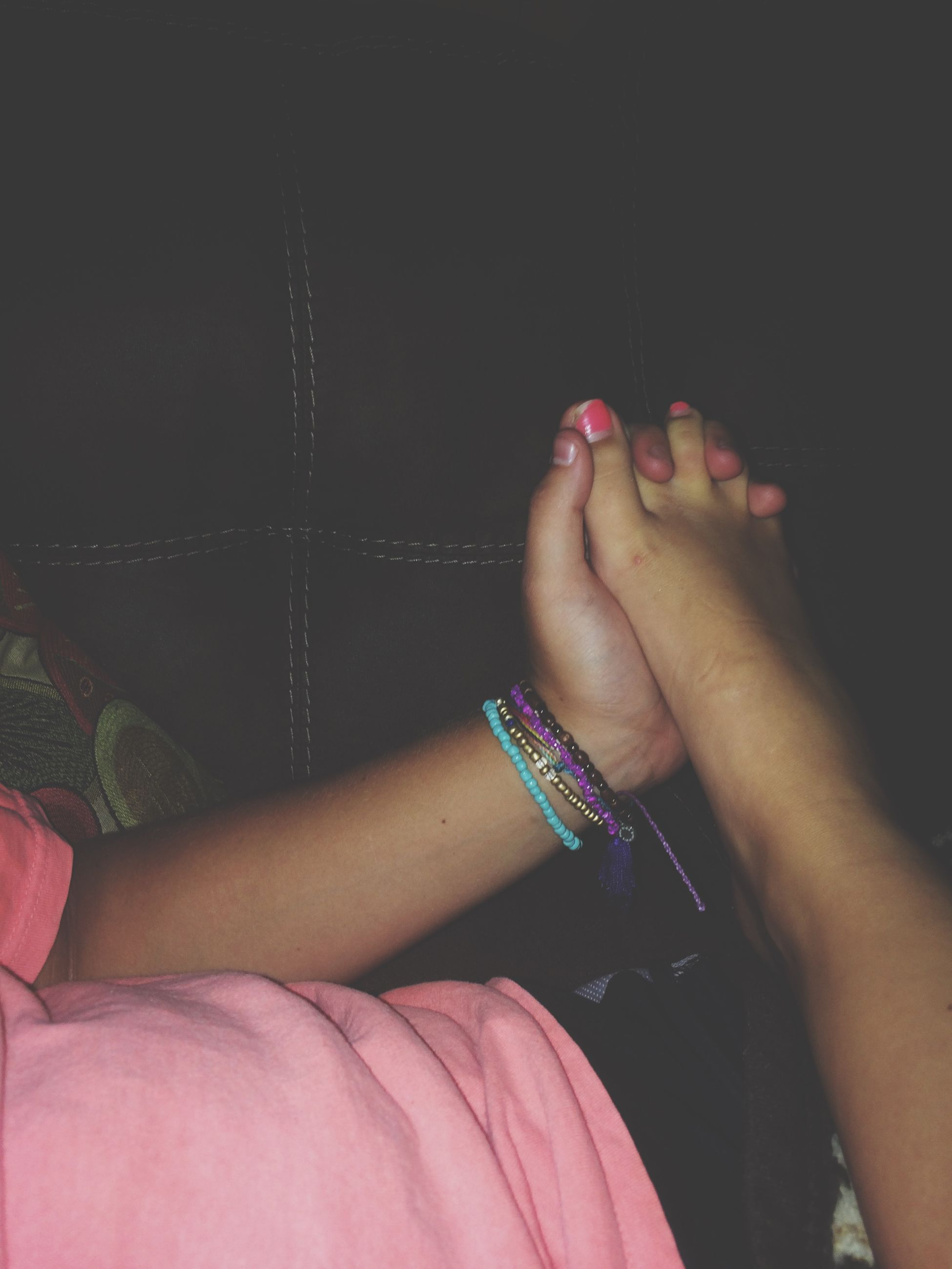 person, indoors, lifestyles, part of, low section, leisure activity, personal perspective, barefoot, human finger, cropped, high angle view, human foot, holding, nail polish, close-up