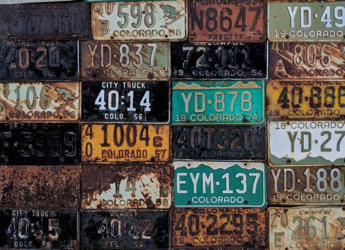 Close-up of old rusty license plates