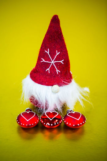 Red Studio Shot Celebration Indoors  Colored Background Close-up Holiday Still Life Christmas No People Santa Claus Hat Decoration Christmas Decoration Holiday - Event Table Celebration Event Santa Hat Event Christmas Ornament