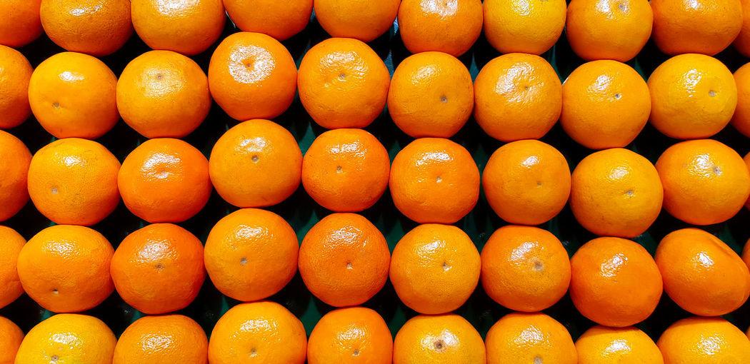 Full frame shot of orange fruits in market