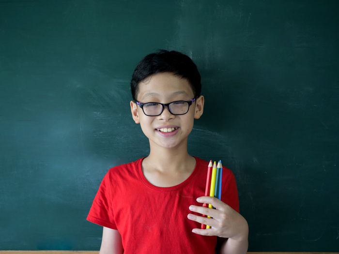 Boys Casual Clothing Child Childhood Drinking Eyeglasses  Front View Glass Glasses Headshot Holding Indoors  Innocence Looking At Camera Males  Men One Person Portrait Real People Red Smiling