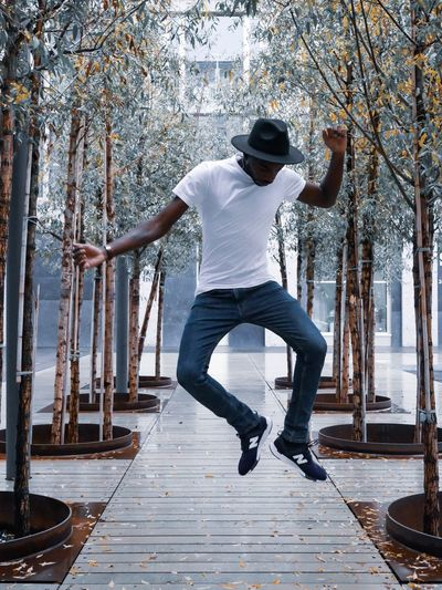 Jump to your life One Person Full Length Real People Casual Clothing Rear View Leisure Activity Lifestyles Day Men Young Men Plant Tree Young Adult Standing Architecture Nature Balance Built Structure Outdoors Human Arm