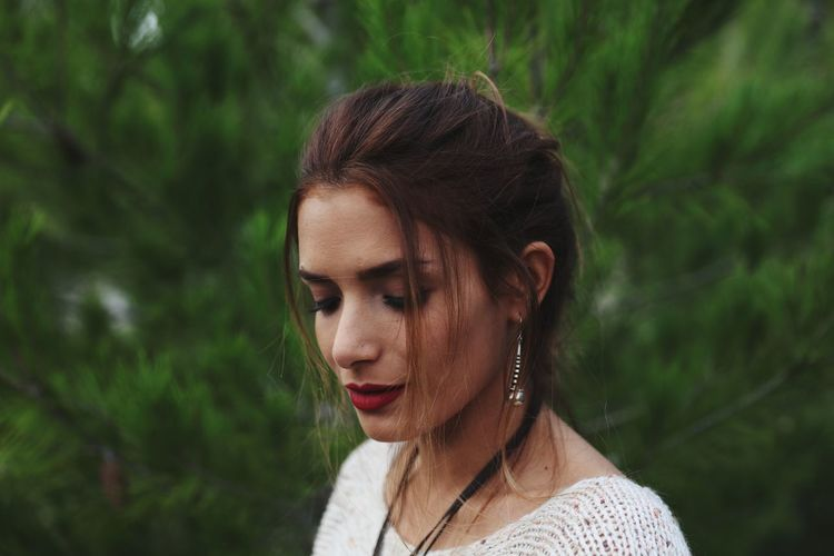 Portrait of a young woman looking away