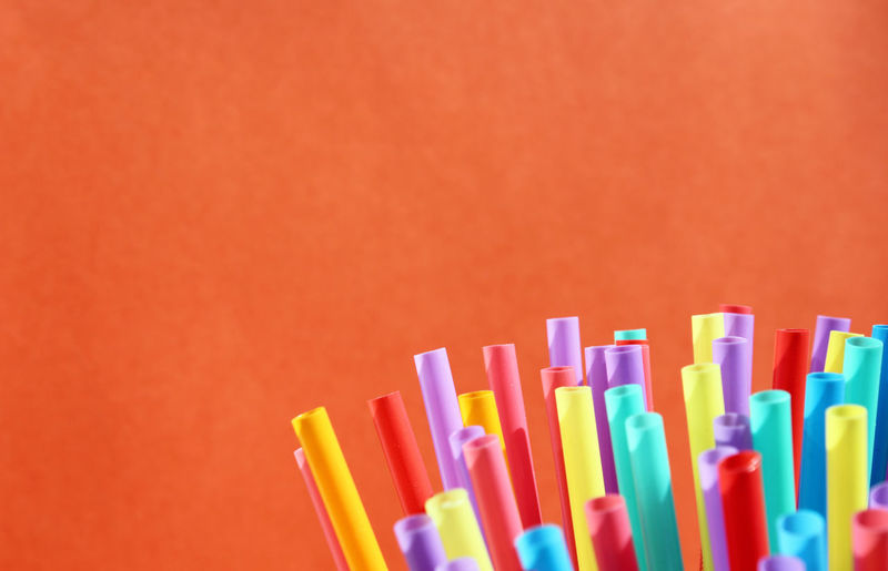 Close-up of multi colored pencils against pink background