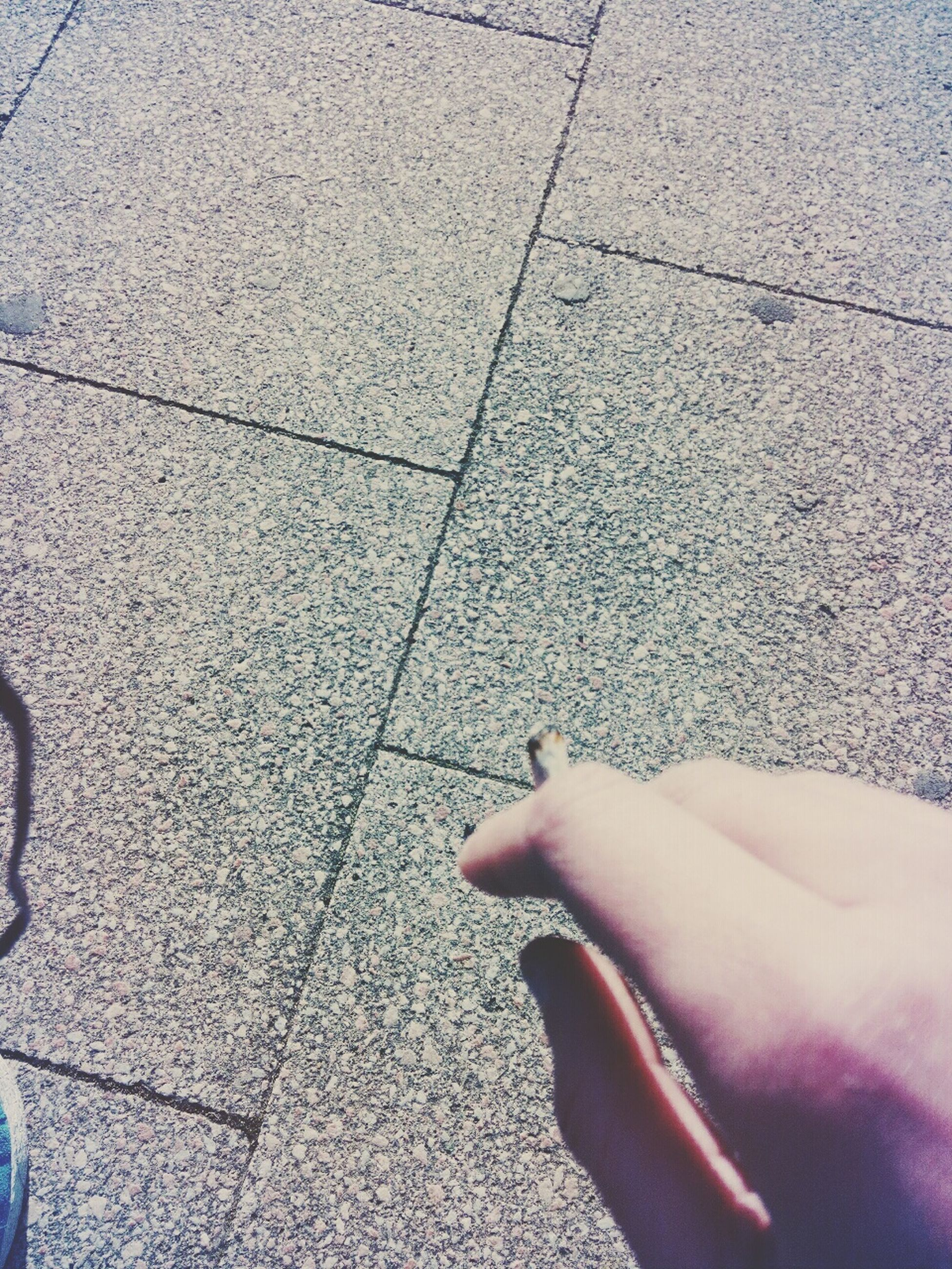 low section, person, high angle view, shoe, street, human foot, personal perspective, cobblestone, lifestyles, tiled floor, footwear, paving stone, part of, standing, sidewalk, unrecognizable person