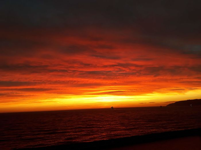 Sunset Eyem Nature Lovers  Eyemcolorphotos Fireinthesky Marseille Sunset Sea Orange Color Dramatic Sky Scenics Beauty In Nature Outdoors Nature No People Water Tranquility Red Silhouette Cloud - Sky Tranquil Scene Sky Vacations