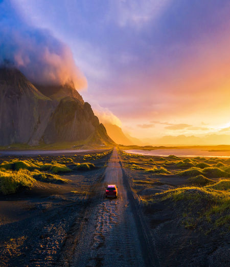 Scenic view of road against sky during sunset