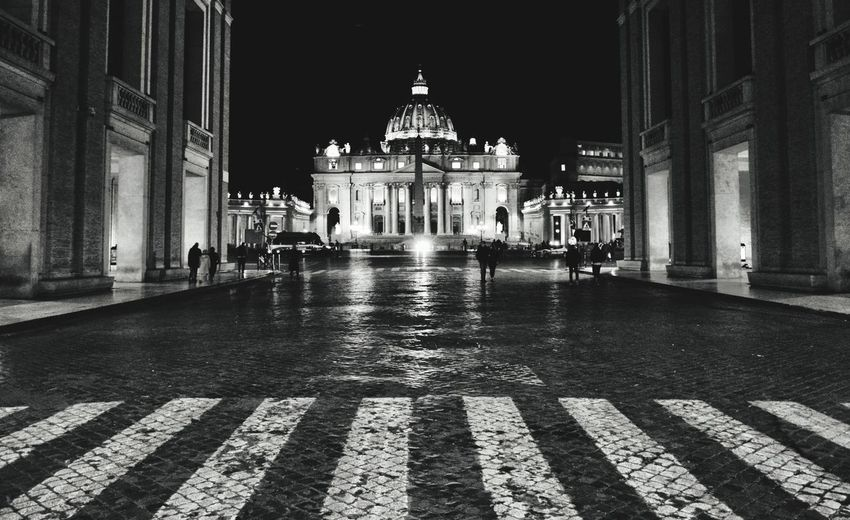 View of wet street at night
