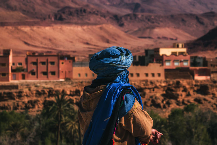 Rear view of woman standing on mountain