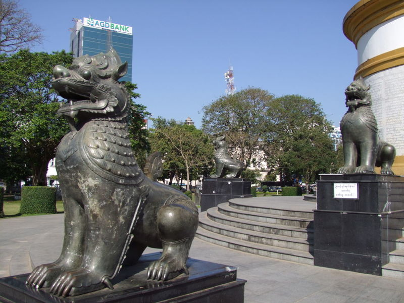 Bronze Lions at the Independence Monument Animal Representation Blue Sky Bronze Lions Bronze Statues Buddhist Art Buddhist Culture City Clear Sky Clear Sky Composition Full Frame Independence Monument Lion Statues Lions Myanmar No People Outdoor Photography Park Pedestal Sunlight Tourist Attraction  Tourist Destination Travel Destination Tree Yangon
