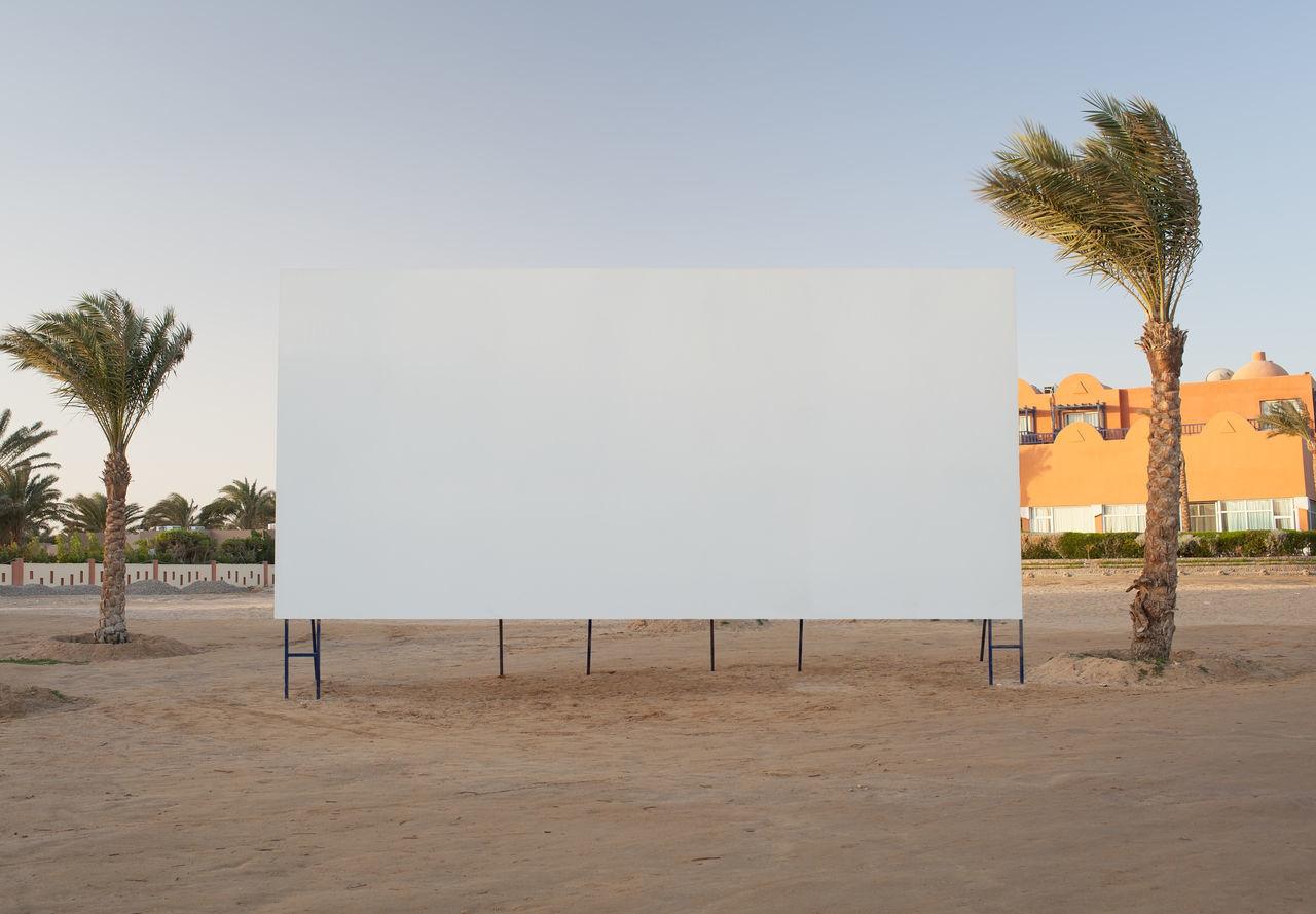 Blank Billboard On Beach Against Sky
