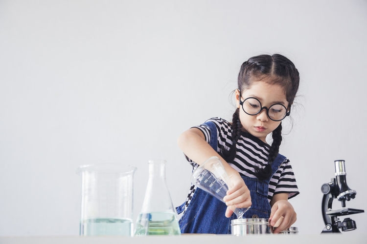 Girl looking at camera on table