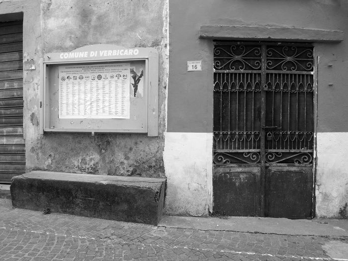 Iron door and bulletin board Black & White Bulletin Board Italia Old Town South Italy Architecture Black And White Black And White Photography Building Exterior Built Structure Calabria Closed Door Iron Door No People Outdoors Verbicaro