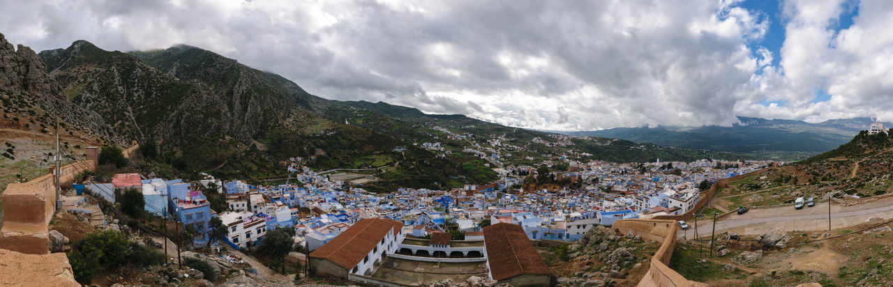 An awesome panoramic view over the blue painted and famous city Chefchaouen in Morocco. It is located in the Rif Mountains. The sky is cloudy. Africa Architecture Background Berber  Blue Chaouen Chefchaouen City Culture Medina Morocco Mountain Nature No People Old Panorama Panoramic Rif Rif Mountains Scenics Sky Street Town Travel View