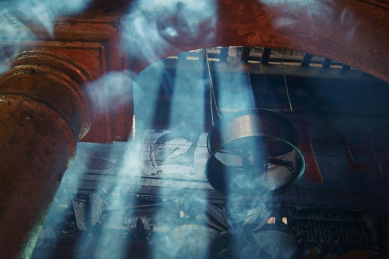 Low angle view of smoke in pagoda