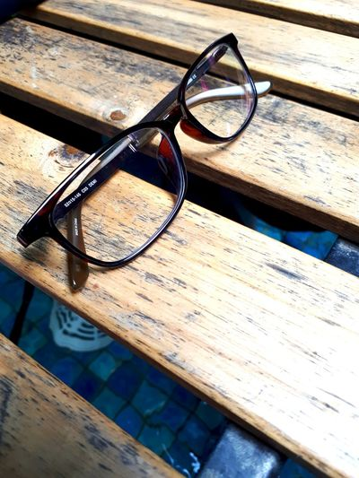 Sunglasses Eyeglasses  Eyewear Eyesight Table Wood - Material High Angle View Reflection Cool Glasses No People Day Reading Glasses Eye Test Equipment Close-up Optometrist Outdoors Glasses Rustic Style Rustic Wood Rusticbeauty Rustic Glass Glasses :) Rustic Living Rustic
