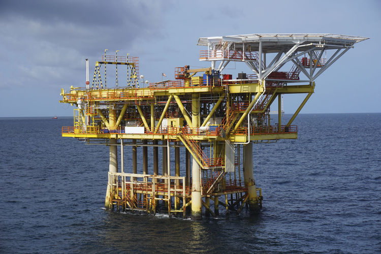 Oil and gas industrial. Drilling platform in the middle of the sea. Black Gold Business Offshore Production Safety First! Built Structure Commercial Drilling Rig Exploration Fuel And Power Generation Hazard Signs Horizon Over Water Industry Mega Structure Nature No People Occupational Safety And Health Offshore Platform Oil And Gas Oil Industry Outdoors Petroleum Sea Sky Water