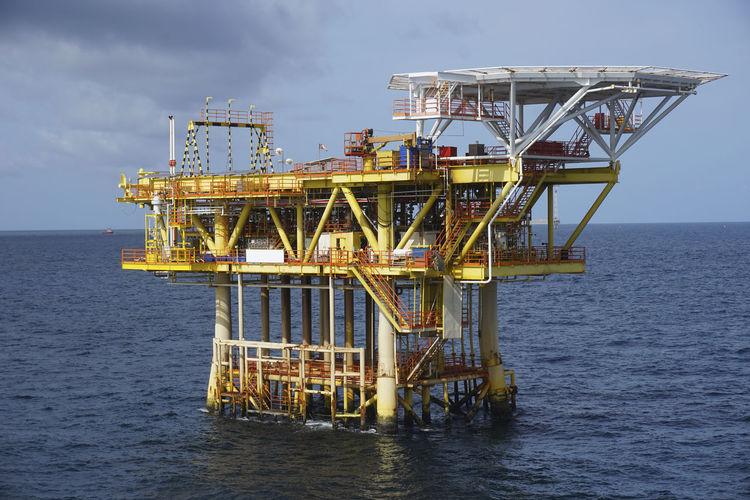 Offshore Platform In Sea Against Sky