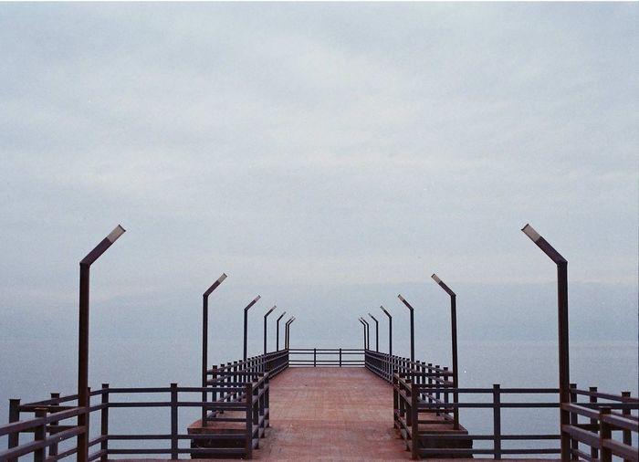Staircase By Sea Against Sky