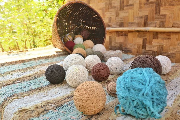Cotton thread ball ,yarn Textured  Textile Nature Hobby Beautiful New Pattern Image Cotton Thread Ball Colorful LINE Close-up Woolen Fabric For Sale Display Wooden Needlecraft Product