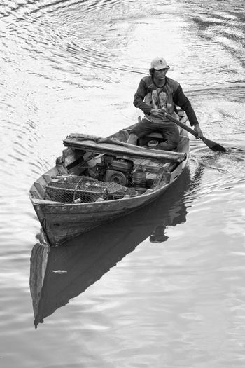 Nautical Vessel Water Mode Of Transport Waterfront Transportation Outdoors Moored One Person Day Lake Nature People Fisherman Fishing Boat Boat Seascape Nature Fishing Net Monochrome Blackandwhite Transportation Transport Traditional Beauty In Nature Fishing Time