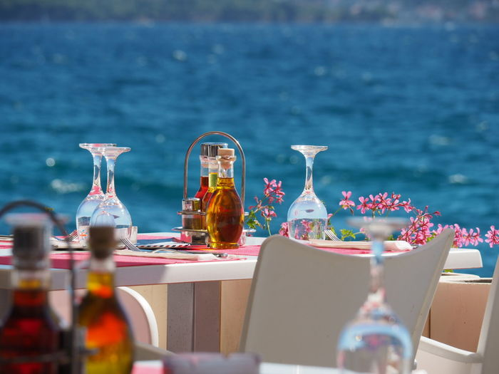 Zadar,Croatia Chill Mode StillLifePhotography Sea Restaurant Scene Wine Glass Restaurant Menage Flowers Restaurant Table No People Water Table Setting Table Chair Oil And Vinegar
