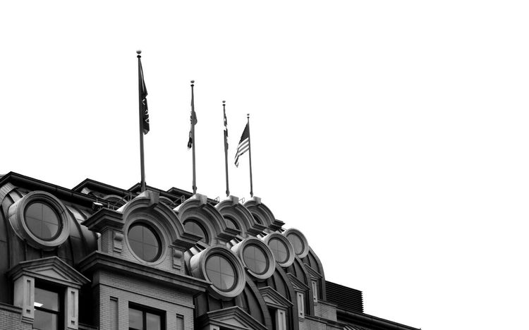 Architecture B&w B&w Photography Black & White Black And White Building Exterior Built Structure Circles Clear Sky Copy Space Day Flag Low Angle View No People Outdoors Repeated Repeating Sky