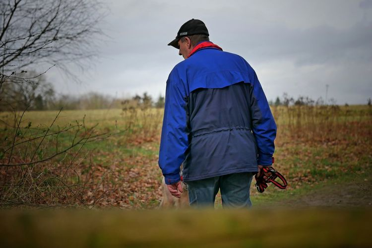 Rear view of man standing on field