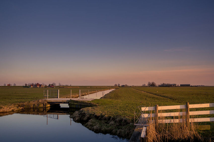 Beauty In Nature Canal Clear Sky Copy Space Environment Field Grass Land Landscape Nature No People Non-urban Scene Outdoors Plant Reflection Scenics - Nature Sky Sunset Tranquil Scene Tranquility Water