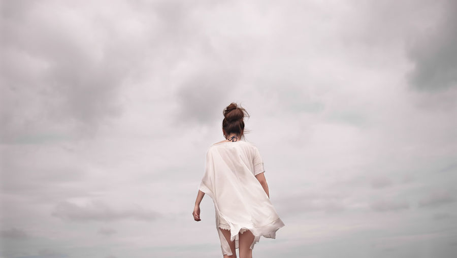 Beach Bun Casual Clothing Cloud Cloud - Sky Cloudy Cloudy Cloudy Skies Female Full Length Lifestyles Low Angle View Minimal Rear View Sky Standing Walking Weather White Woman Market Reviewers' Top Picks