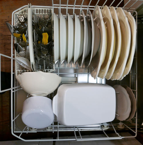 High angle view of washed utensils in dish rack