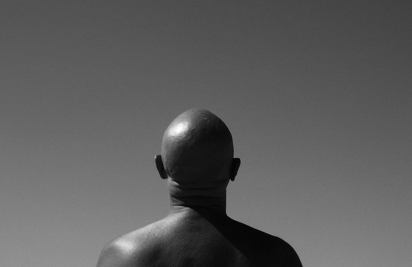 Bald Man Baldness Black & White Black And White Casual Clothing Close-up Day Fine Art Photography Focus On Foreground Headshot Leisure Activity Lifestyles Low Angle View Nature Outdoors Sky